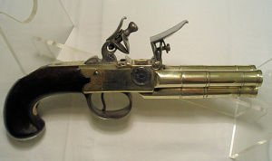 Click to enlarge a 70 bore 3 barrelled flintlock boxlock tap action pistol with brass action and barrels, made by Perry, London