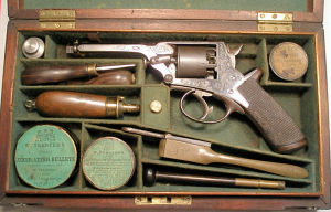 Click to enlarge a cased 80 bore 4th Model Tranter percussion revolver, with a full complement of accessories