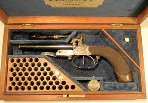 Click to enlarge a cased double barrelled 7mm pinfire pistol by Murcot