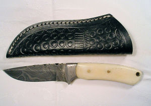 Click to enlarge a custom made 4in. damascus bladed hunting knife circa 2010