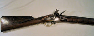 Click to enlarge a flintlock trade musket by Henshaw