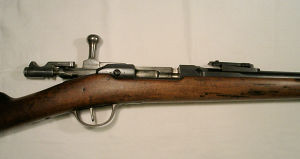 Click to enlarge an 11.15 x 59 French Gras battlefield rifle, retaining much original finish to barrel and action