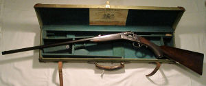 Click to enlarge a cased .300 rook rifle by Rigby