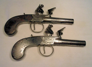 Click to enlarge a pair of 60 bore flintlock boxlock turnoff pistols by Jover