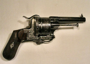 Click to enlarge a Spanish double action ten shot 7mm pin fire revolver