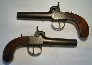 Click to enlarge a very fine pair of 16 bore manstopper overcoat percussion pistols by Fyfe of Greenock.